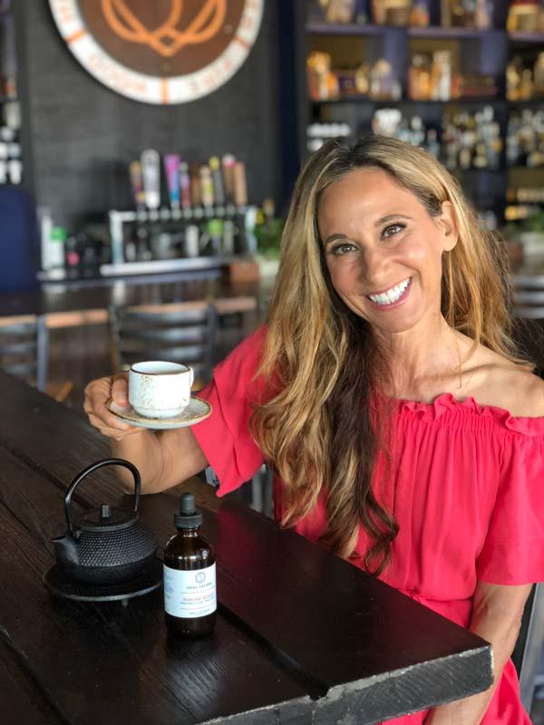 Nora enjoying chinese elixir at Soul Tavern in Miami Beach